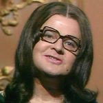 Benny as Nana Mouskouri in 'Benny's All-Star Finale'