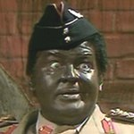 Benny as Idi Amin in 'The Bionic Baby'