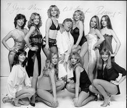 Standing, Left to Right: Jayne Melville, Mandy Perryment, Sue Upton, Benny Hill (seated), Debbie Linden, Victoria Shellard and an unknown. Kneeling, Left to Right: Louise English, Sharon Bond and Tina Bond (The Bond Sisters) and an unknown.